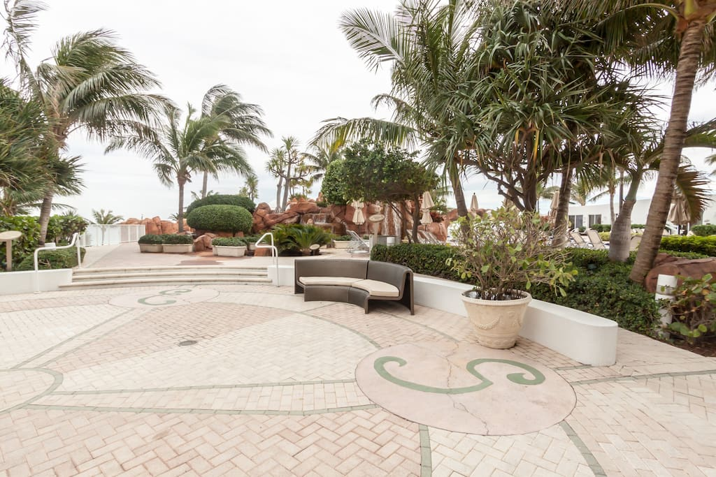 Enjoy the scenery and the breeze in the surrounding area by the outside pool.