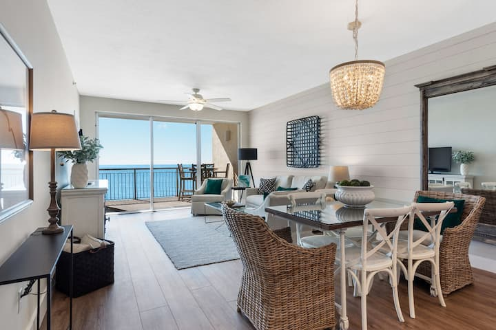 Updated beachfront condo w/ scenic balcony, lagoon-style pool & more!