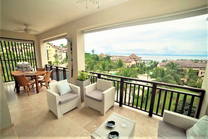 The private spacious balcony has amazing Ocean views and comes a with lounge area, dining table and barbecue.