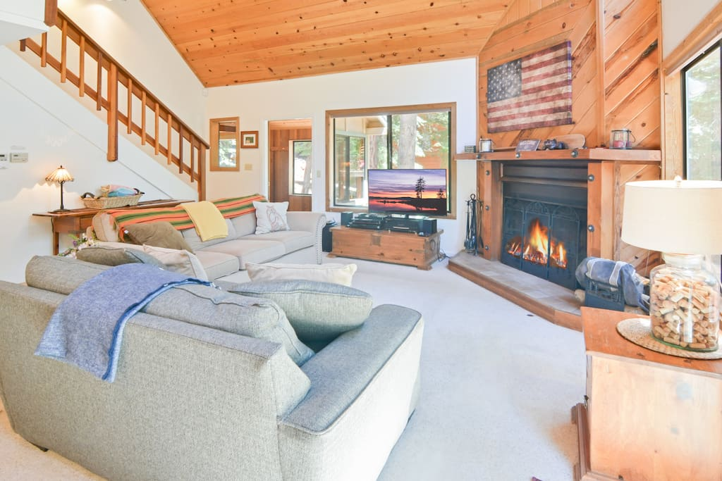 Cathedral ceilings, large picture windows, and a generous fireplace in the main living area