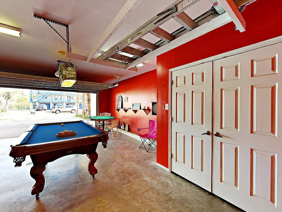 The garage has been converted into a game room, complete with a pool table and poker table.