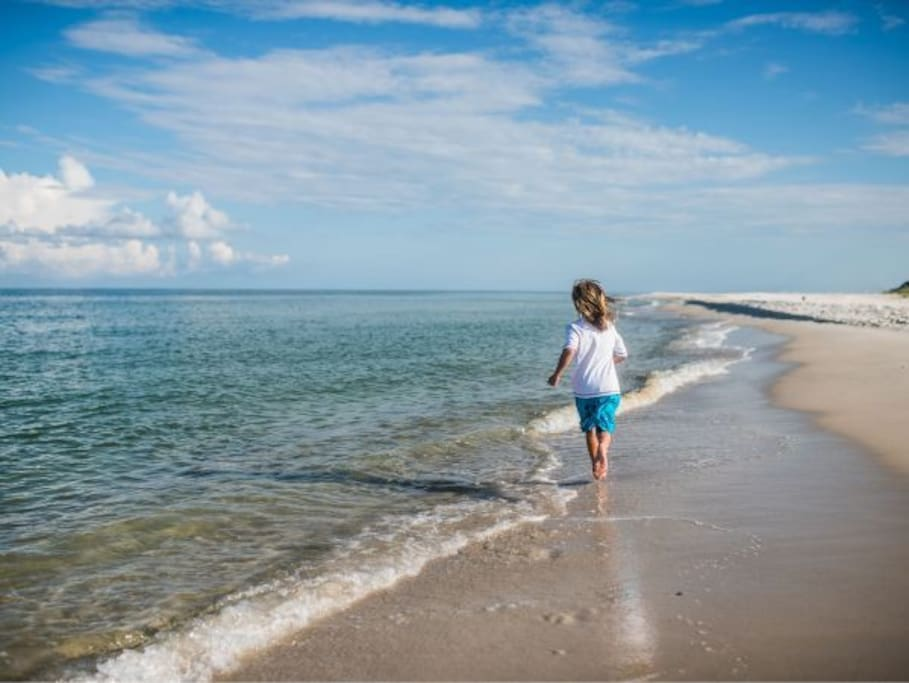 Beautiful white sand beaches right outside your door.
