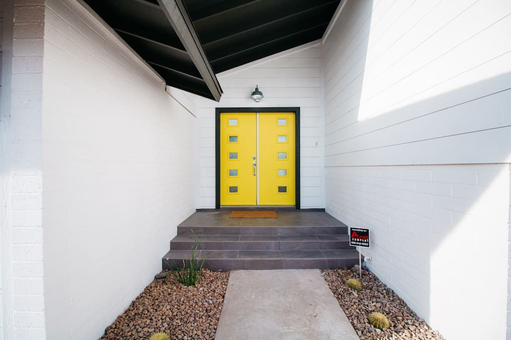 This bright yellow door is sure to bring a smile to your face!