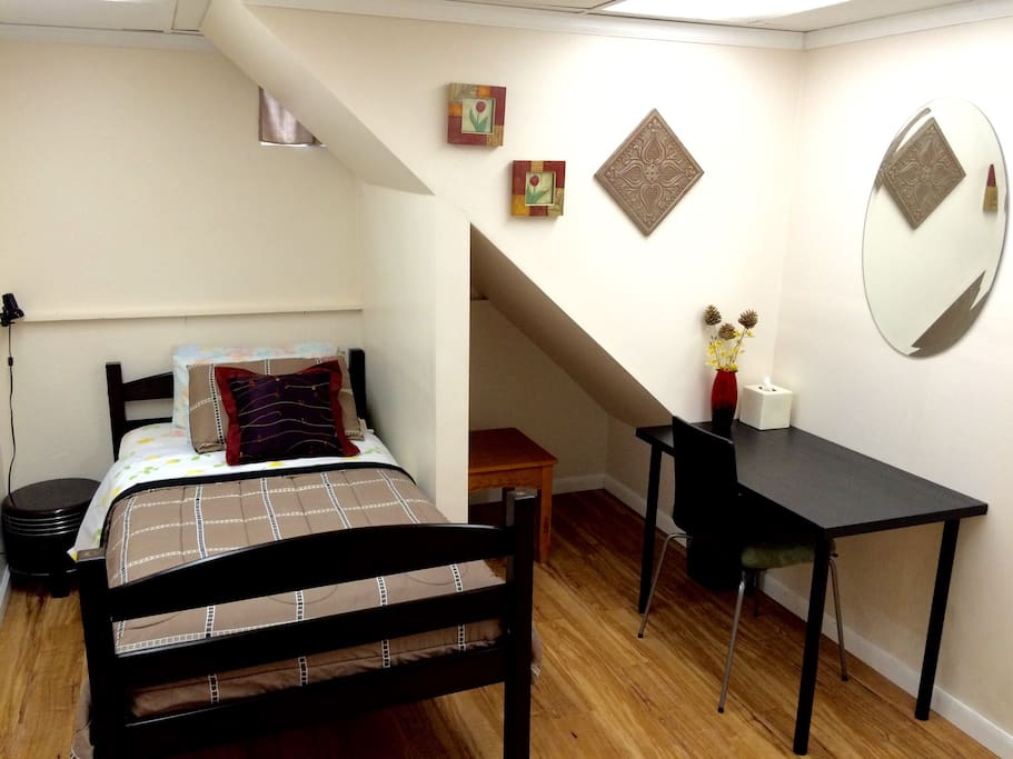 The room, located under the stairs, with tiny non-standard windows, walk-in closet and tables.