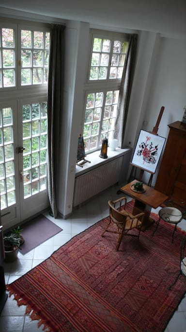View of the living room. The windows give on to a private courtyard.