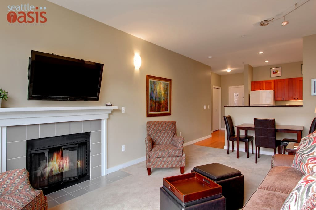 With a comfy couch, large HDTV, and an indoor fireplace, it'll be hard to leave the living room.
