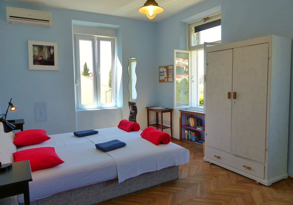 This is our blue room on the second floor with three windows, a double bed and lots of light.