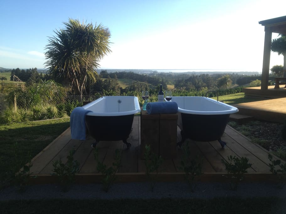 Luxury Outdoor baths for guest use with a view.