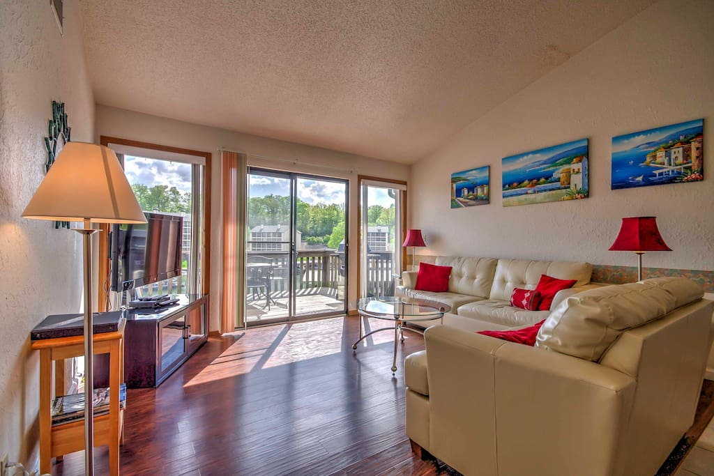 With vaulted ceilings and large glass windows, this condo offers an open and airy atmosphere.