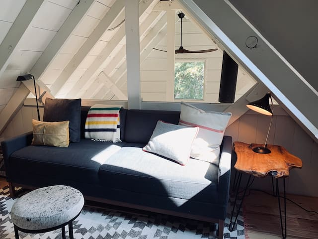 Queen size sofa bed in reading loft- just in case your dinner guests decide to stay the night.