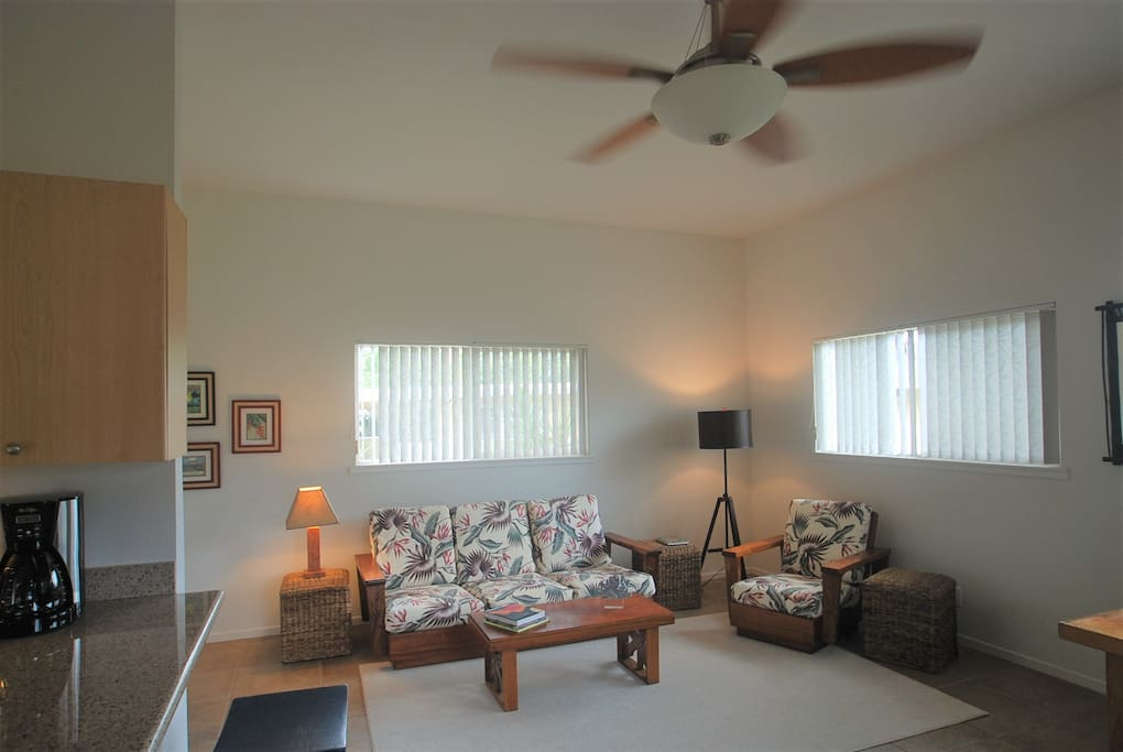 Large comfortable living room for you, furnished with vintage Koa wood sofa and chair