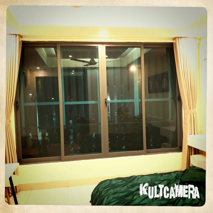 Wide window with anti mosquito netting and curtain