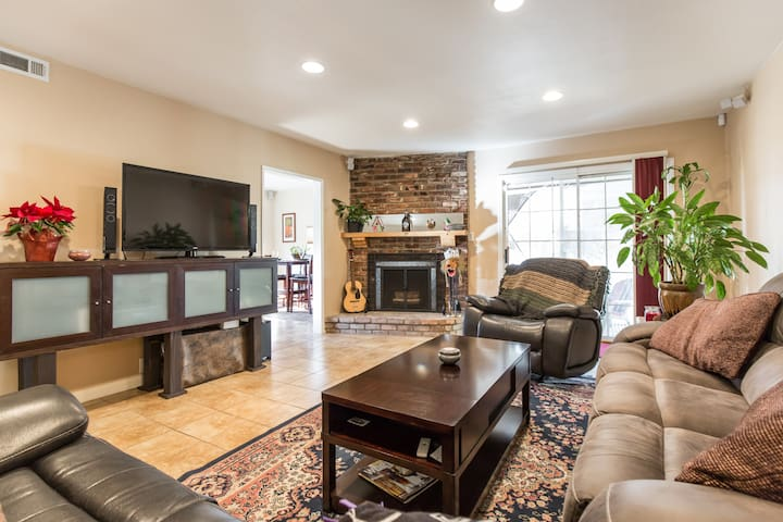 Cozy Living Room with comfy couches and surround sound TV