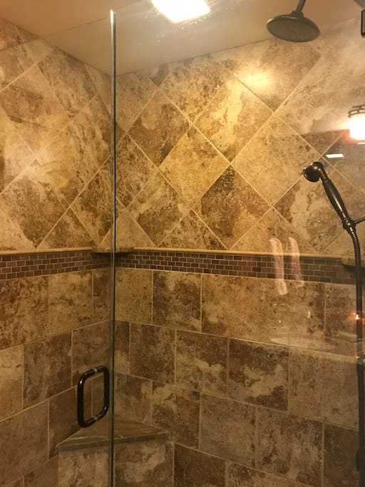 Extra large walk in shower, heated tile floors and mood lighting.