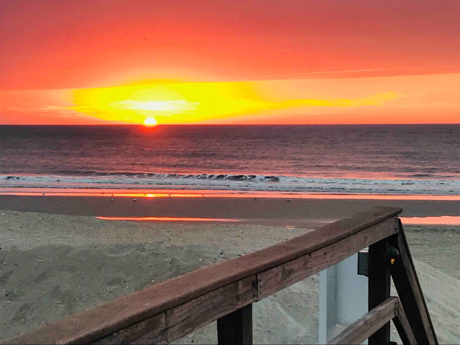 Watch the sunrise from your balcony or take a few steps down to the beach!