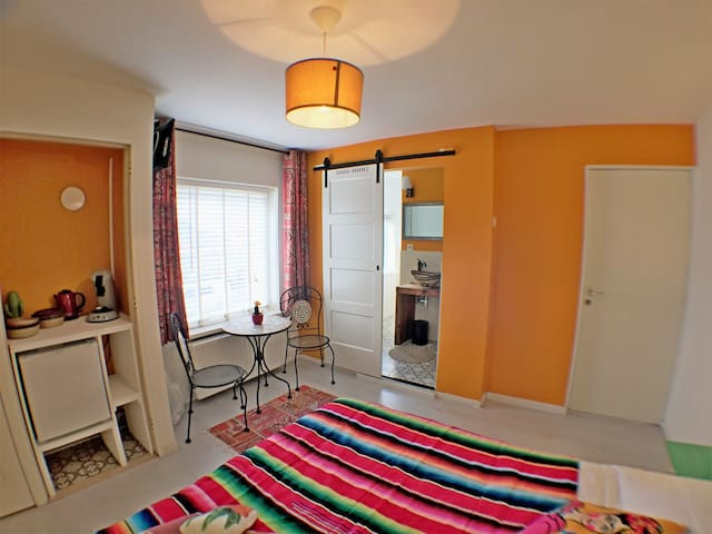 Colorful clean room, 150m from the beach!