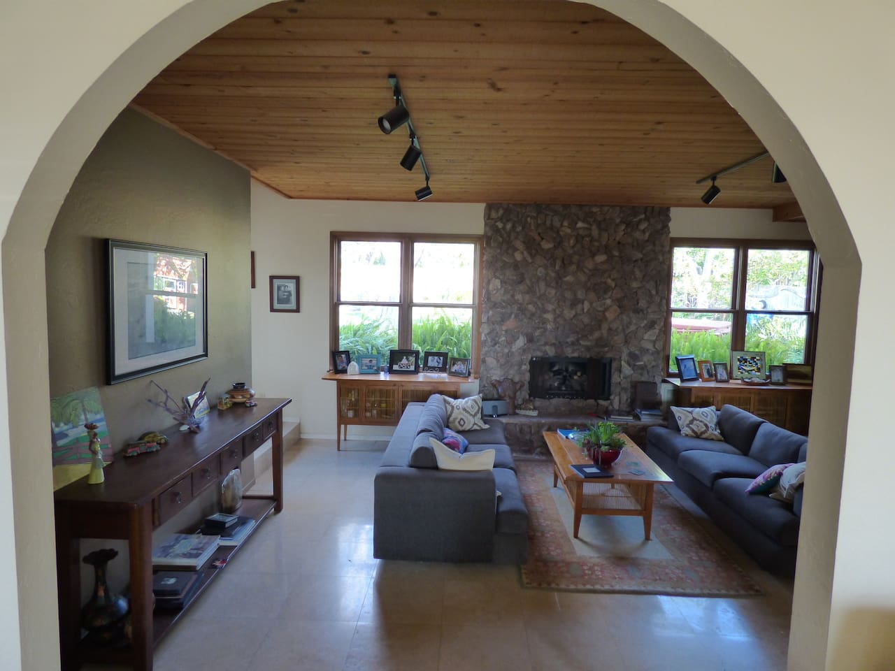 large family room with fireplace looking out to beautiful back yard
