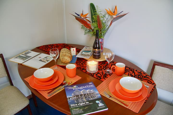 Dinning table, Your welcome package is local wood fired bread, 2 eggs, homemade jam, local honey, milk & orange juice. Comprehensive brochures on the region with suggestions on the local restaurants.
