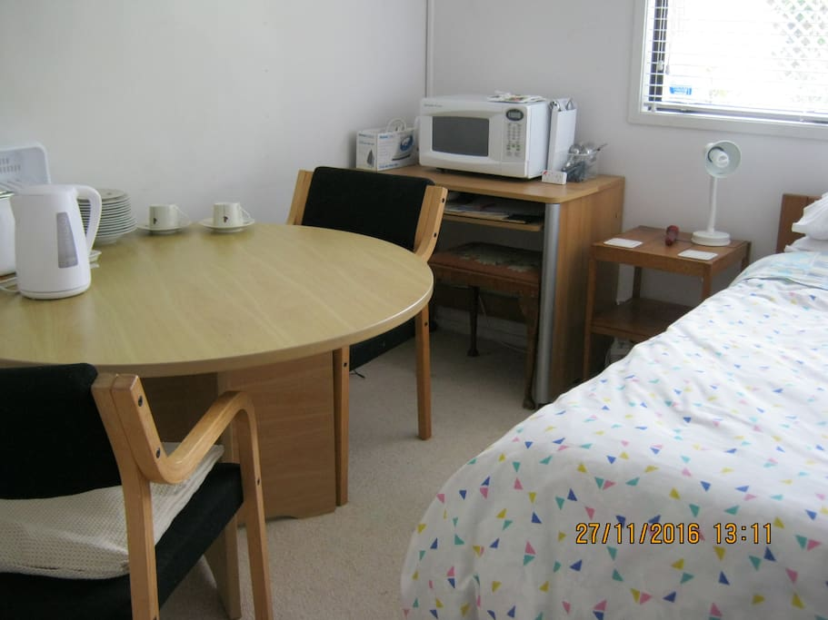 Single bed and breakfast table