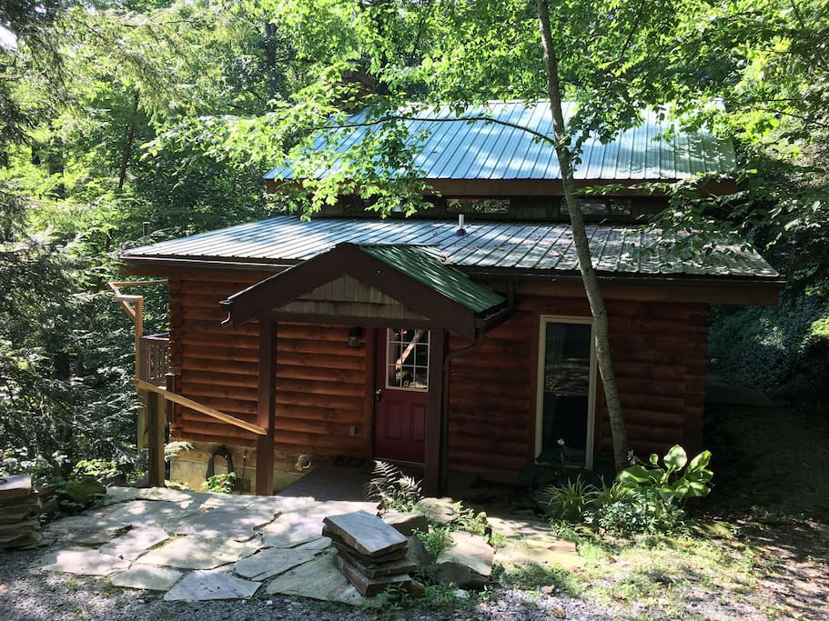 The cabin is surrounded by private and serene forest.