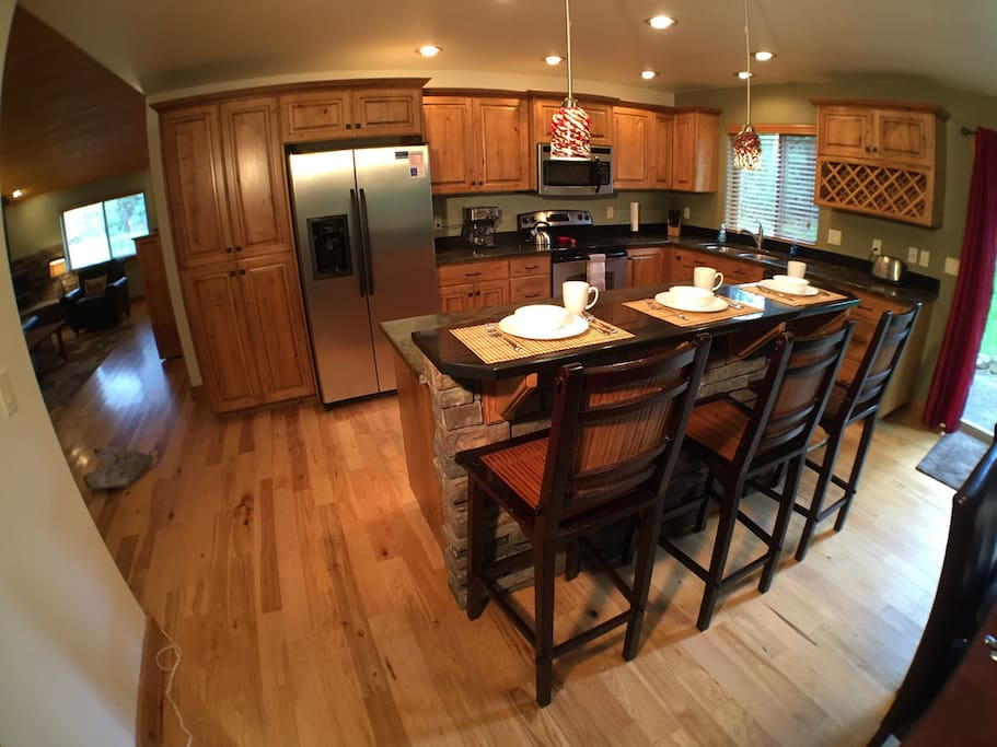 Kitchen is enjoyable to cook in with everything a chef would need.  There's plenty of space among the granite counter tops and stainless appliances to enjoy a meal together.
