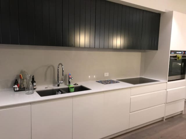 Modern kitchen with all appliances and 2 dishwashers
