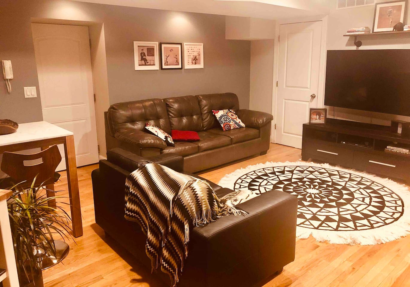 """Living room has 60"""" Ultra TV, one couches (pulls out and has a mattress), one leather love seat and complete surround sound."""