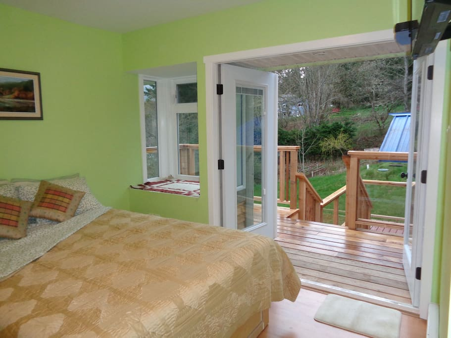 Dublin patio doors to private deck and hot tub access.Queen bed.