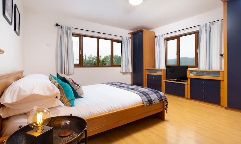 Bedroom 1 with kingsize bed and en-suite bathroom