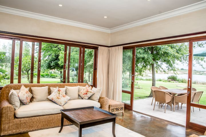 Big sliding windows and doors to bring the outside in.