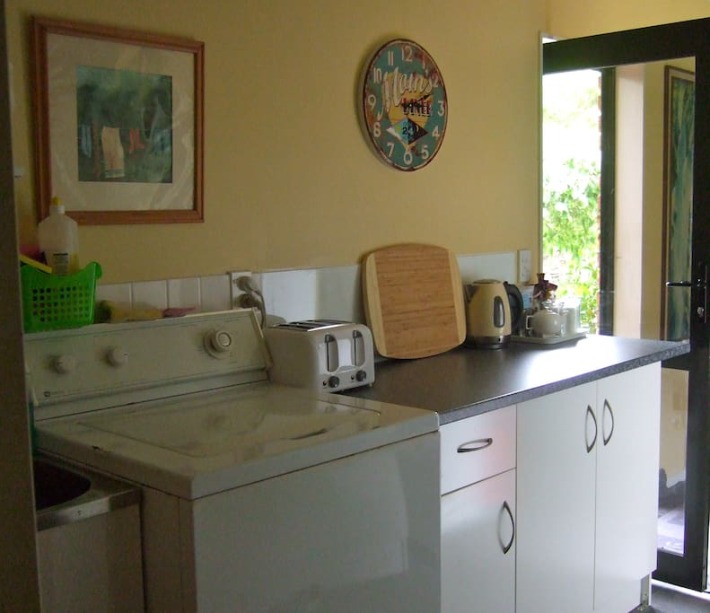 Shared guest / campers kitchen in communal area. Very clean, tidy and new