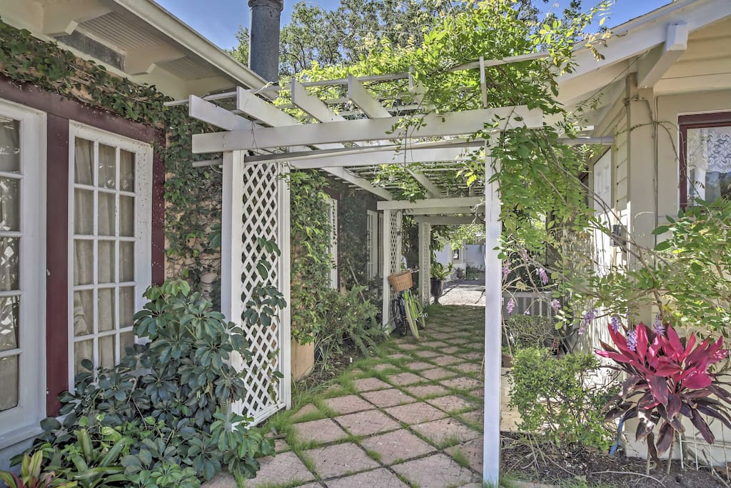 Pergolas draped in Chocolate Cream Mandevilla vines,  Jasmine, Bongainvillea, and Wisteria arbors adorn the backyard.