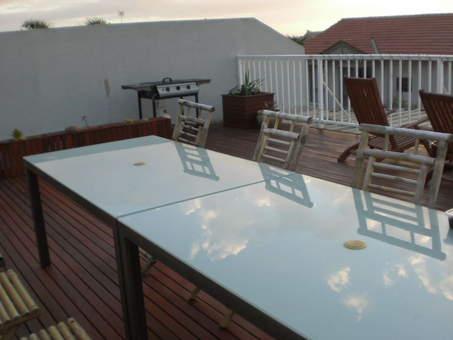 Large rooftop deck with sea views