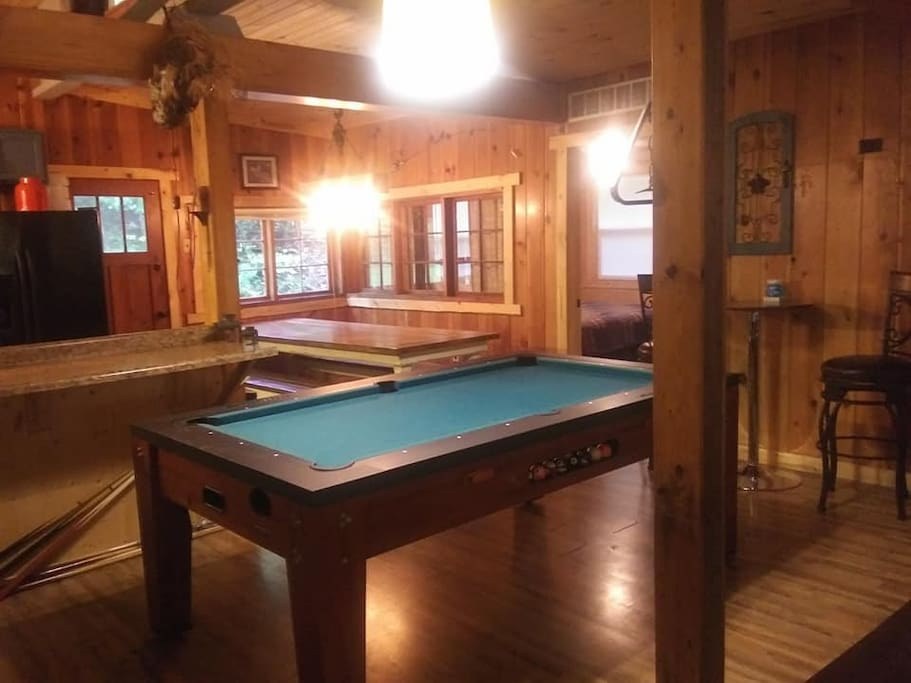 Pool table flips to air hockey, ping pong can be added! 9 foot farm table with bench seating.