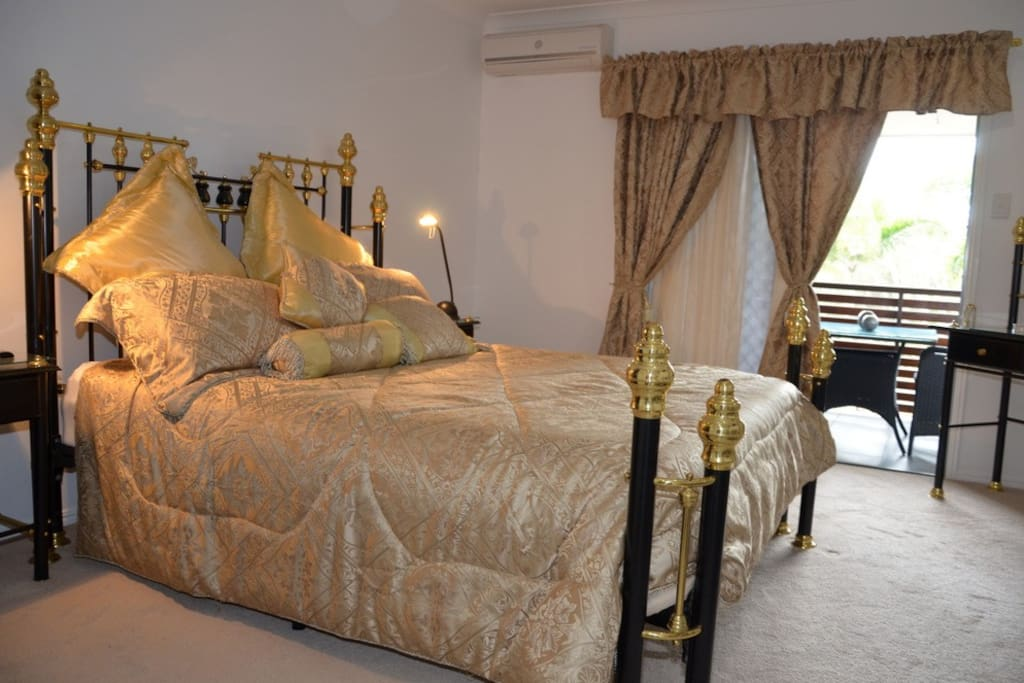 The luxury Brighton Suite with private balcony, large bathroom and spa bath