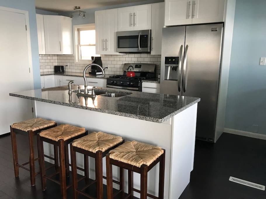 Kitchen with island and seating
