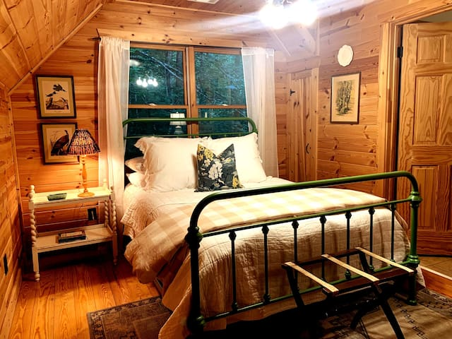 The upstairs loft bedroom has a Queen Bed and it's own full bathroom with shower!