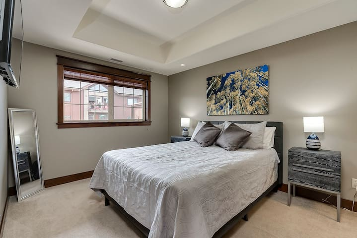 Bedroom features a Queen bed and a large walk-in closet with built-in drawers, shelving and hanging bars with hangers for your use!