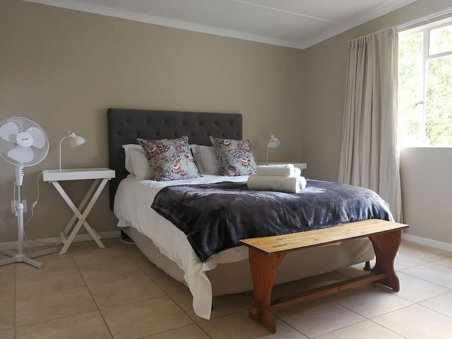 Main Bedroom with queen bed and additional single bed