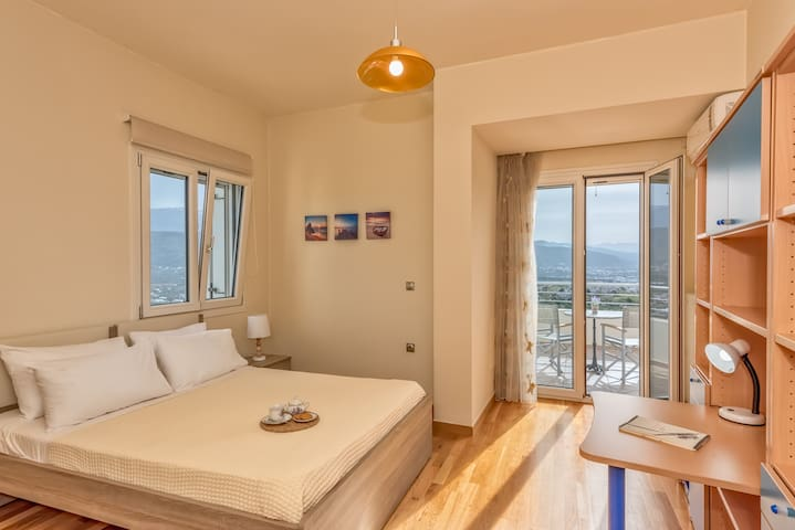 Third bedroom with queen size bed. There is a balcony with view to sea, mountains and city of Chania. Bedroom with aircondition.