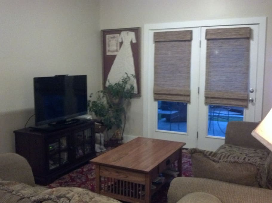 Comfy couches with flat screen tv. Open the doors to enjoy a nice breeze off the patio