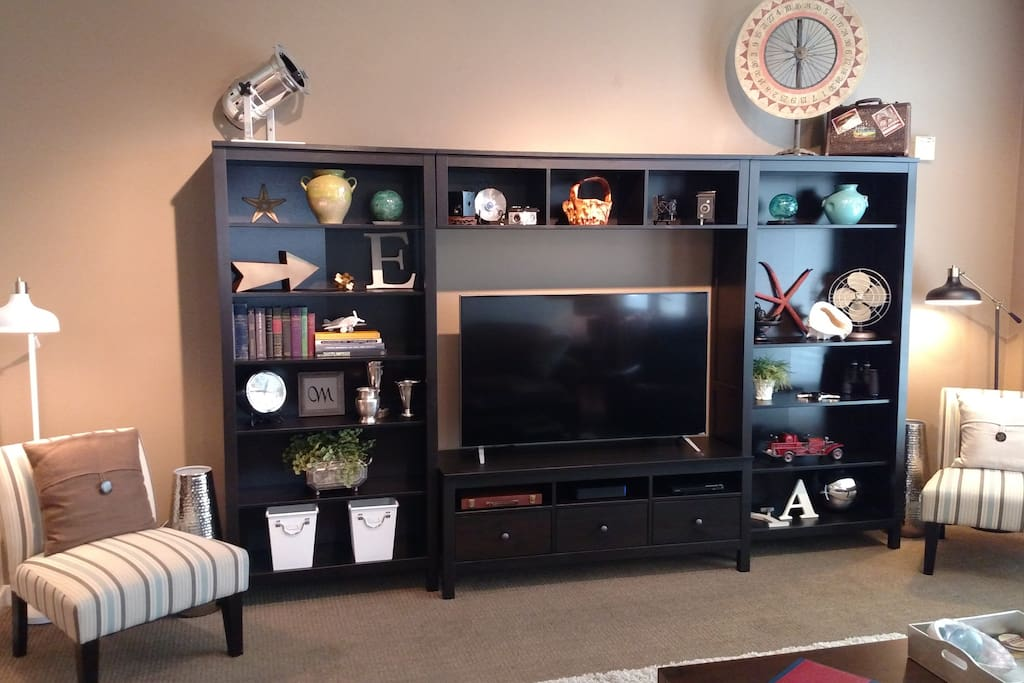 "Entertainment center with 55"" LED TV, DVD Player, Xfinity Cable Box."