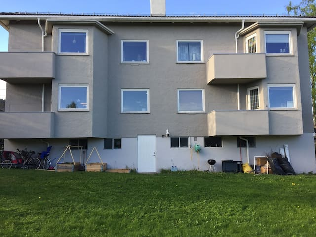 Back. Its the appartment on left side, 1st floor