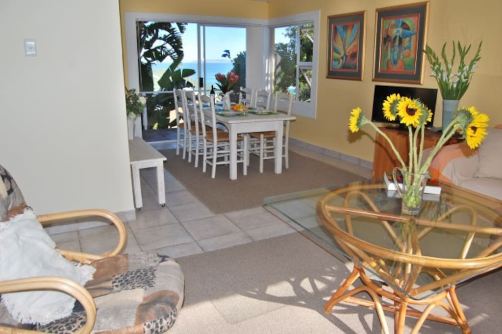 The dining area and patio with seaview beyond