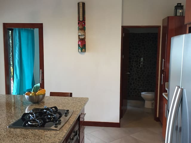 Second bedroom and full bathroom with river rock shower off the Great Room.