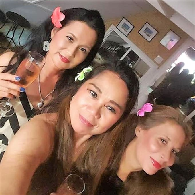 My name is Elizabeth and I am the girl on the right. These are my two girlfriends Josie and Vicky. See our Hawaiian flowers we got in Downtown Hilo. Take a trip down there and see the Museum.