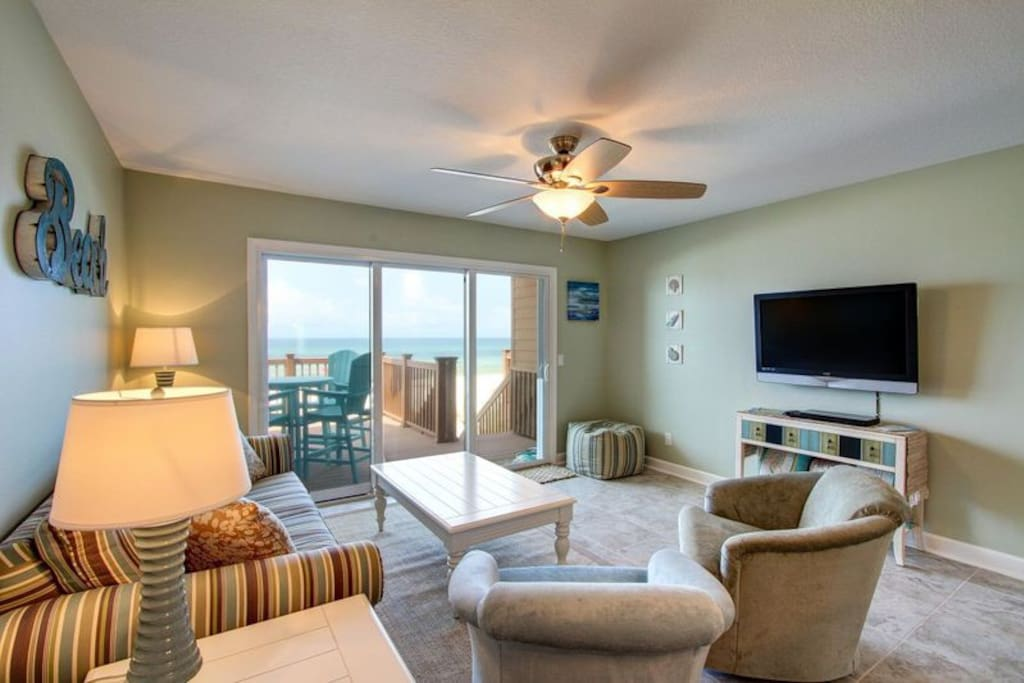 Spacious and Bright Living Area Adorned with High-end Furnishings and Massive Smart TV!