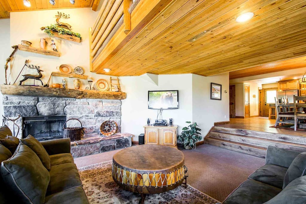 The second floor and main living area is the center of the home and looks out to the mountains and into the gourmet kitchen and formal dining room.