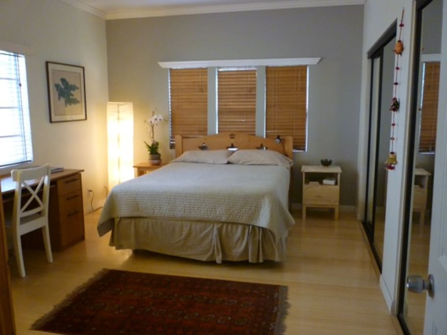 bedroom with bamboo floor, desk & lots closet space