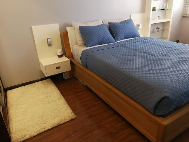 Bedroom is equipped with Google Hub, a voice-activated speaker powered by Google. Use voice commands to enjoy music (Spotify), get answers from Google (such as traffic, weather, news, etc.) and manage everyday tasks like setting and snoozing alarm.